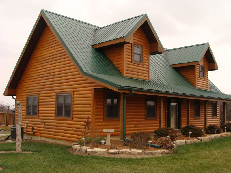 Staining and finishing your log home log medics inc for How to stain log cabin